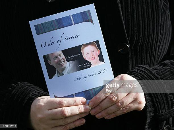 Mourner holds the order of service for the funeral of Colin McRae and his son Johnny outside at EastChapel, Daldowie Crematorium on September 26,...