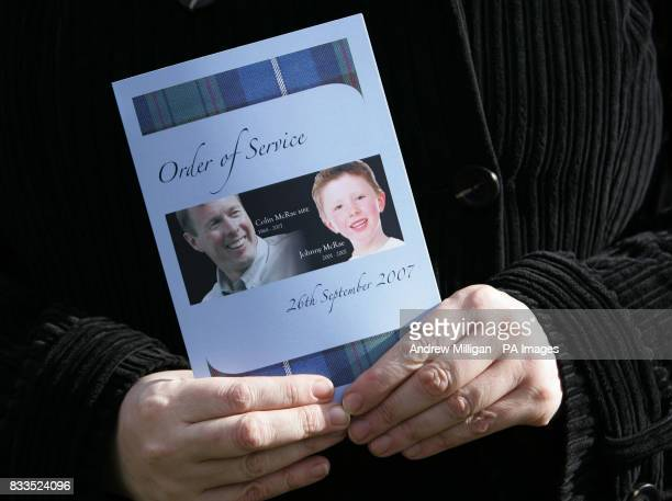 Mourner holds the order of service for the funeral of Colin McRae and his son Johnny outside at East Chapel, Daldowie Crematorium.