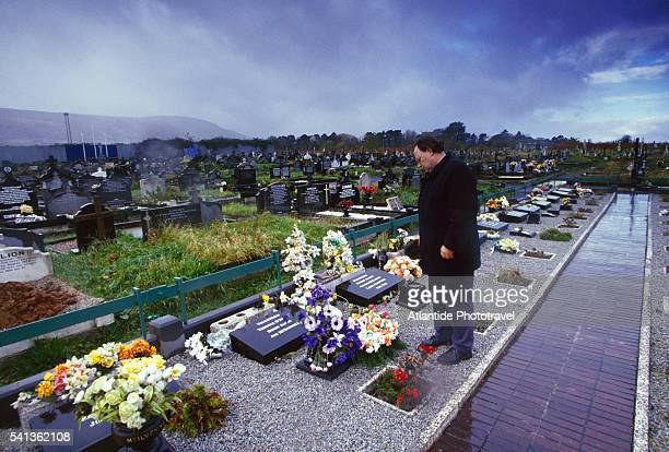 mourner in milltown cemetery in belfast - falls road stock pictures, royalty-free photos & images