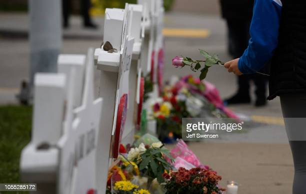A mourner lays flowers at a memorial for victims of the mass shooting that killed 11 people and wounded 6 at the Tree Of Life Synagogue on October 29...
