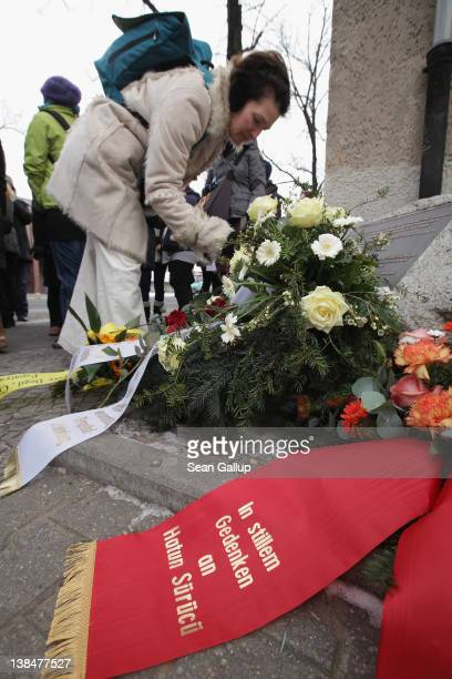 A mourner lays flowers at the memorial to Hatun Surucu on the 7th anniversary of her murder near the site where Surucu was killed on February 7 2012...