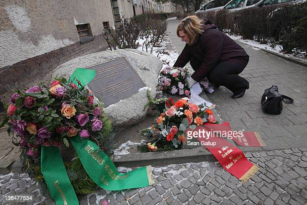 Mourner lays flowers at the memorial to Hatun Surucu on the 7th anniversary of her murder near the site where Surucu was killed on February 7, 2012...