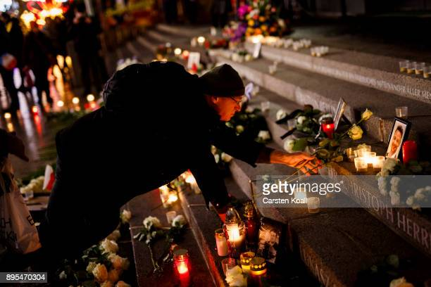 A mourner lays roses at a memorial to victims following its inauguration at the site of the 2016 Christmas market terror attack at Breitscheidplatz...