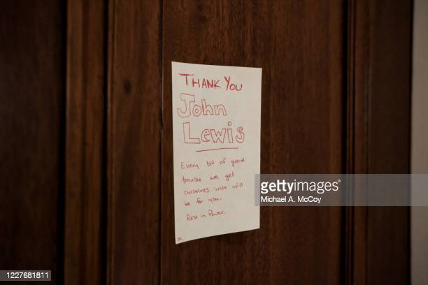 Mourner leaves a note outside of the office of the late Rep John Lewis n the Cannon House Office Building in on July 18, 2020 in Washington, DC. John...