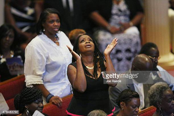 Mourner look up the funeral service of Ethel Lance who was one of nine victims of a mass shooting at the Emanuel African Methodist Episcopal Church,...