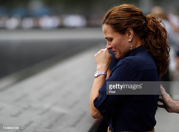 A mourner looks at names of lost loved ones during tenth anniversary ceremonies of the September 11 2001 terrorist attacks at the World Trade Center...