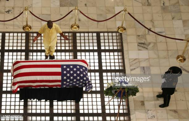 Mourner pays their respects at the flag draped casket of Rep. John Lewis as he lays in repose at the Georgia State Capitol on July 29, 2020 in...
