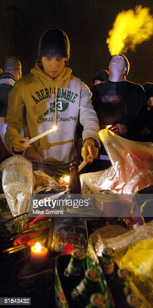 Mourner places a candle at a makeshift memorial outside of the Alrosa Villa Club on December 9, 2004 in Columbus, Ohio. According to authorities, a...
