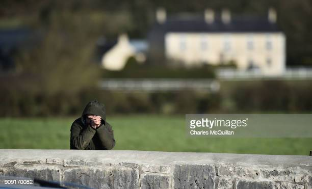 A mourner prays by a wall as family carry the late Dolores O'Riordan from St Ailbe's Church Ballybricken on January 23 2018 in Limerick Ireland The...