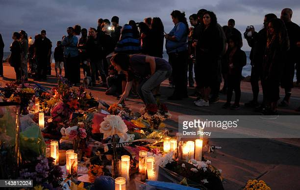 A mourner puts flowers at a memorial set up in the driveway of former NFL star Junior Seau's house May 3 in Oceanside California The former...