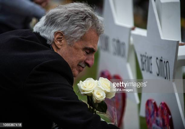 A mourner seen placing flowers on the memorials erected outside of the Tree of Life Synagogue in Squirrel Hill Members of Pittsburgh and the Squirrel...
