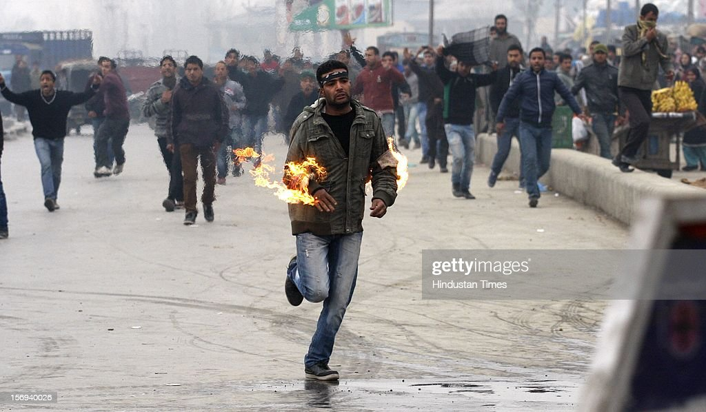 A mourner sets himself on fire during a procession from Batamaloo area in which several mourners got injured, on November 23, 2012 in Srinagar, India. Authorities have imposed severe restrictions to thwart Muharram procession in Srinagar. Police has erected barbed wire barricades on roads and deployed hundreds of police and paramilitary men to enforce the restrictions. Shiite Muslims all over the world mourn the slaying of Imam Hussein, grandson of Prophet Mohammad, during Islamic month of Muharram.