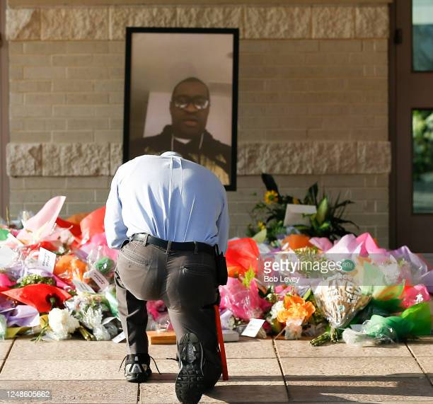 A mourner takes a moment before the funeral for George Floyd at the Fountain of Praise church on June 9 2020 in Houston Texas Floyd died May 25 while...