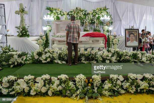A mourner views the remains of General Tinio Mayor Ferdinand Bote who was assassinated by unidentified gunmen on motorcycles during his funeral wake...