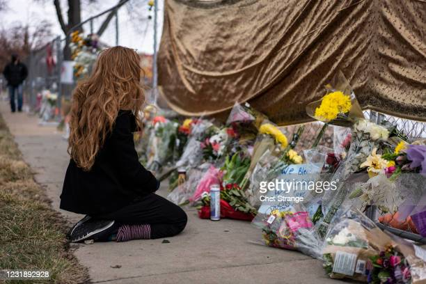 Mourner visits the location where a gunman opened fire at a King Sooper's grocery store on Monday on March 23, 2021 in Boulder, Colorado. Ten people...