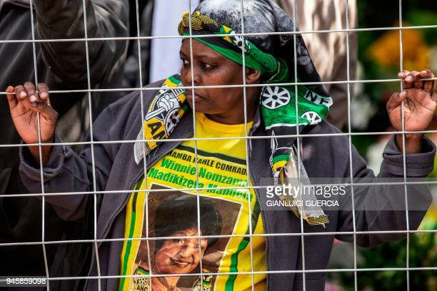 A mourner waits for the arrival of the coffin of Winnie Mandela late antiapartheid icon and exwife of former South African president Nelson Mandela...