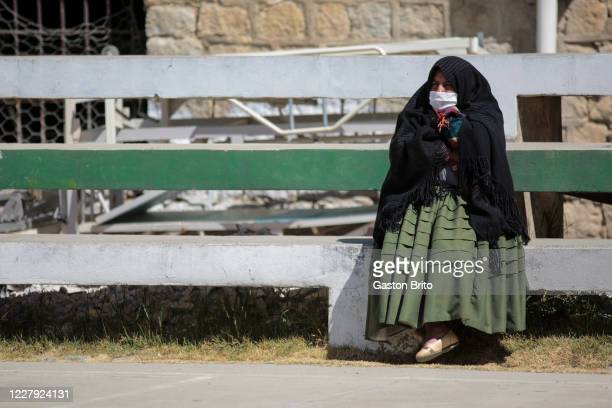 A mourner waits on the stands of a the soccer field next to the morgue on August 5 2020 in La Paz Bolivia Hospital de Clínicas of Miraflores had to...