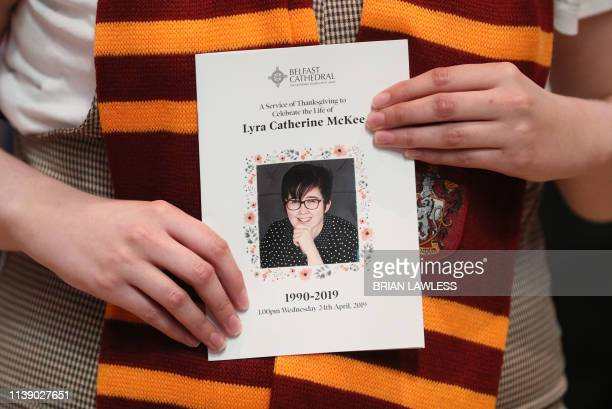 TOPSHOT A mourner wearing a Gryffindor scarf holds an order of service as she arrives to attend the funeral service of journalist Lyra McKee who was...