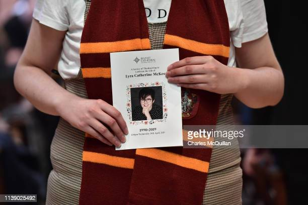 A mourner wearing a Hogwarts scarf holds the order of service for the funeral for journalist Lyra McKee at St Anne's Cathedral on April 24 2019 in...