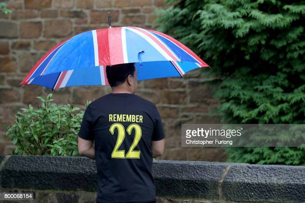 A mourner wearing a 'Remember 22' shirt attends the funeral service of Manchester attack victim Alison Howe at St Anne's Church on June 23 2017 in...