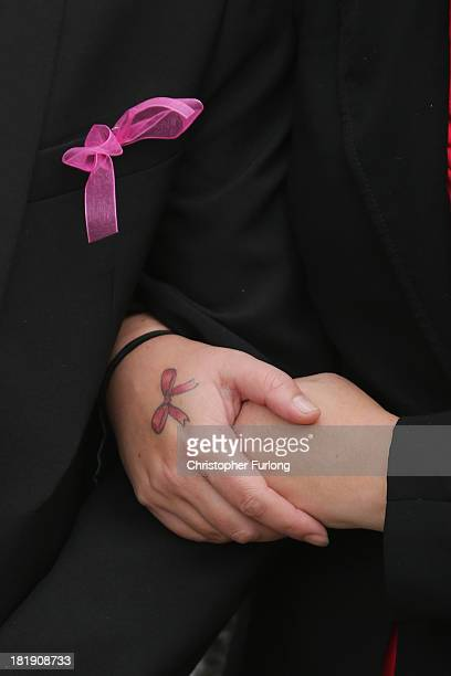 A mourner wears a pink ribbon and a pink ribbon tattoo during the funeral service of murdered schoolgirl April Jones at St Peter's Church on...