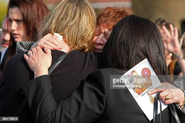 A mourner weeps as the funeral cortege of Sapper Mark Quinsey who was murdered in Northern Ireland leaves Immanuel Church in Highters Heath on March...