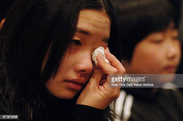Mourner weeps during a traditional Buddhist funeral service for Stuyvesant High School freshman April Lao at the Chun Fook Funeral Home in Flushing,...