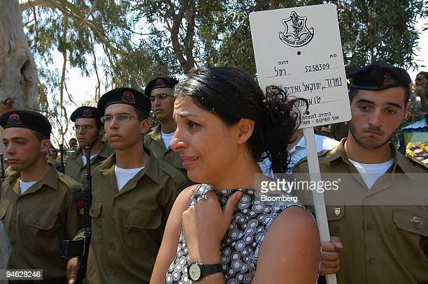 A mourner weeps during the funeral of Israeli soldier Sergeant Nimrod Segev at a cemetery in the northern Israeli town of Rosh Pina Israel Sunday...