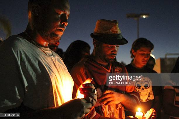 TOPSHOT Mourners and activists hold a candle light vigil during a rally in El Cajon a suburb of San Diego California on September 28 in protest of...