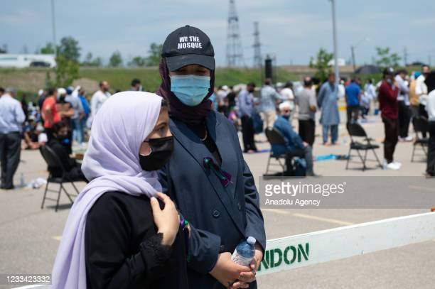 Mourners and supporters gather for a public funeral for members of the Afzaal family at the Islamic Centre of Southwest Ontario on June 12, 2021 in...