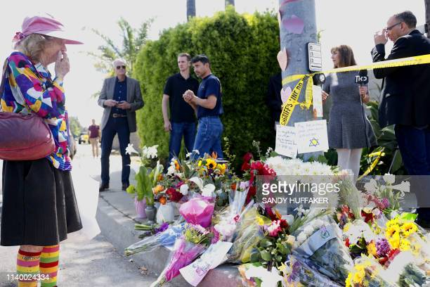 Mourners and well wishers leave flowers at a make-shift memorial acroos the street from the Chabad of Poway Synagogue on Sunday, April 28, 2019 in...