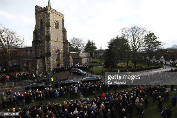 Mourners applaud as the hearse carrying the coffin of former England Football Team Manager Graham Taylor leaves after his funeral at St Mary's Church...