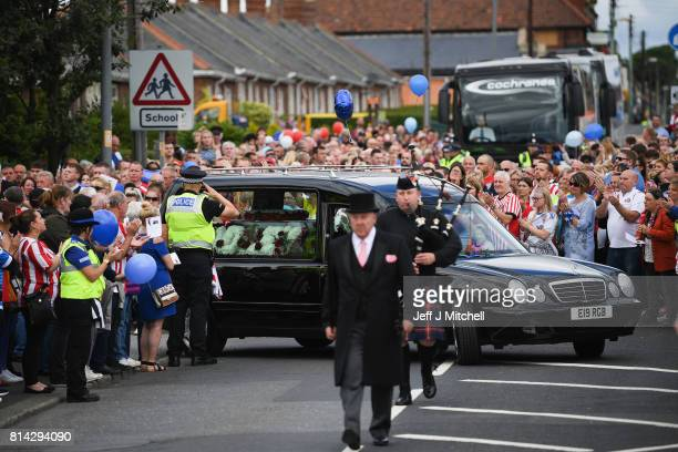 Mourners applaud as the hearse departs St Joseph's Church after the funeral service for six year old Sunderland FC fan Bradley Lowery on July 14 2017...