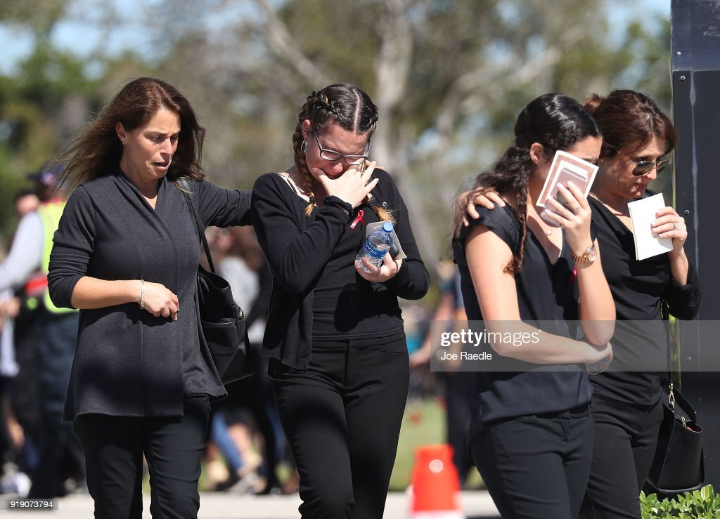 Mourners are seen at the funeral of Alyssa Alhadeff at the Garden of Aaron at Star of David Memorial Gardens on February 16, 2018 in Parkland, Florida. Alhadeff was one of 17 people killed in the February 14 shooting at Marjory Stoneman Douglas High School. Former student Nikolas Cruz has been arrested and charged for the 17 murders.