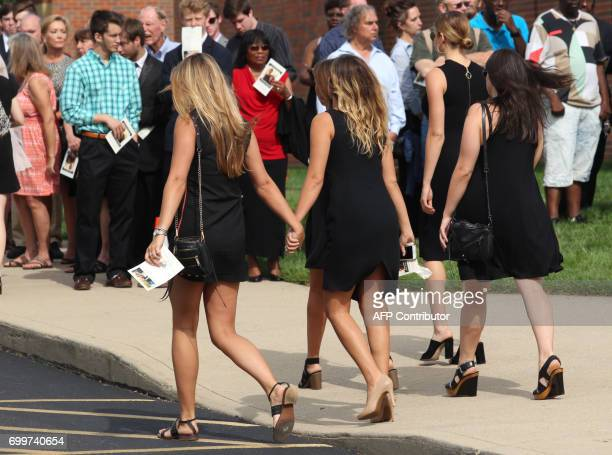 Mourners are seen leaving Wyoming High School in Wyoming Ohio on June 22 to attend the funeral for Otto Warmbier Warmbier an American university...