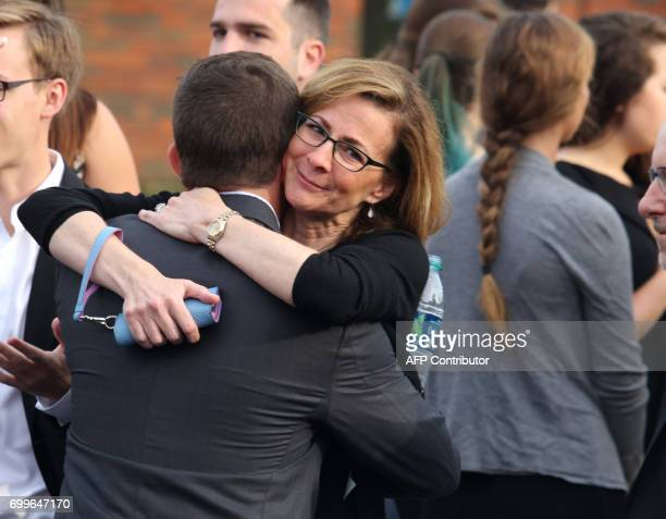 Mourners are seen outside Wyoming High School in Wyoming Ohio on June 22 to attend the funeral for Otto Warmbier Warmbier an American university...