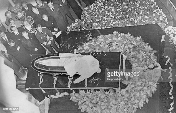 Mourners around the coffin of Argentine First Lady Eva Peron who lies in state at the Ministry of Labour building in Buenos Aires 1st August 1952...