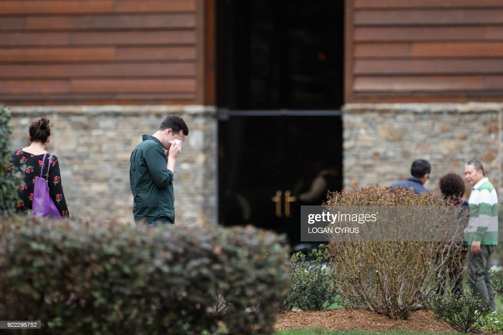 Mourners arrive at the Billy Graham Library in Charlotte, North Carolina to pay respects hours after the announcement that Rev. Graham passed away in his home in Montreat, NC February 21, 2018. US presidents from Jimmy Carter to Donald Trump led the chorus of tributes Wednesday to the influential evangelist Billy Graham, a spiritual advisor to a dozen American leaders who has died at age 99. / AFP PHOTO / Logan Cyrus for AFP / Logan Cyrus