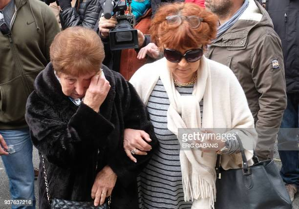 Mourners arrive at the Saint Etienne Church in Trebes in southwest France for a service of remembrance on March 25 two days after a man carried out...