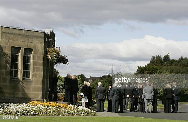 Mourners arrive for the funeral of Colin McRae and son Johnny at East Chapel, Daldowie Crematorium on September 26, 2007 in Glasgow, Scotland. Former...