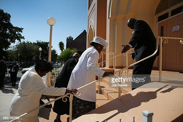 Mourners arrive for the funeral of Corey Jones at the Payne Chapel AME church on October 31 2015 in West Palm Beach Florida The 31 year old was shot...