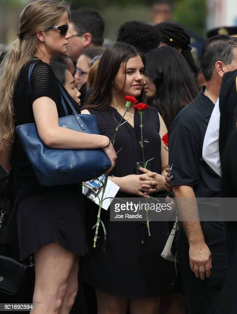Mourners arrive for the funeral of Peter Wang who was a JROTC cadet at Kraeer Funeral home on February 20 2018 in Coral Springs Florida Wang was...