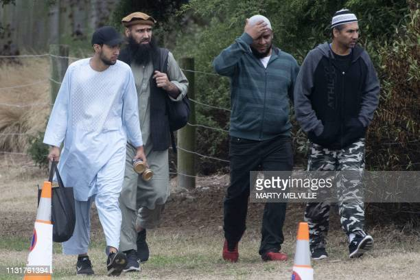 Mourners arrive for the funeral of those killed in New Zealand's twin mosque attacks at Memorial Park Cemetery in Christchurch on March 21 2019 A...