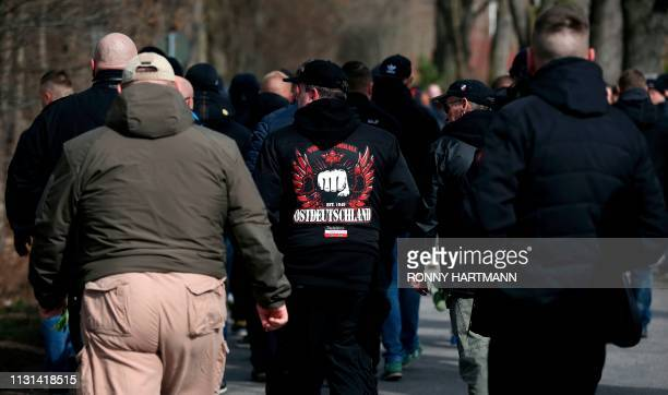 Mourners arrive to attend the funeral of Thomas Haller, a leading figure in eastern Germany's far-right scene and fan of German fourth-tier football...