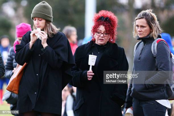 Mourners arrive to pay their respects during a vigil held in memory of murdered Melbourne comedian 22yearold Eurydice Dixon at Princess Park on June...