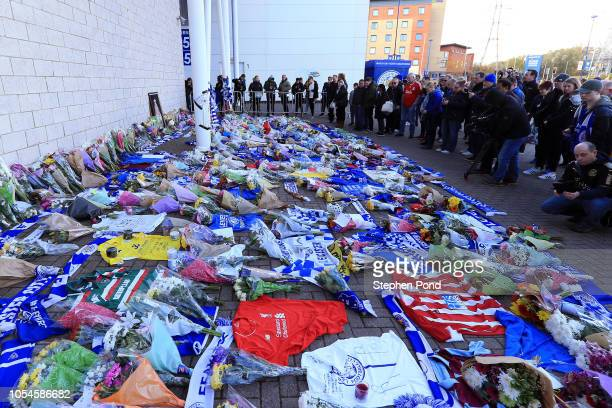 Mourners arrive to pay tributes after the helicopter crash at The King Power Stadium on October 28 2018 in Leicester England The owner of Leicester...