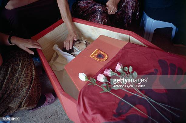 Mourners at a funeral in Rogova Kosovo say a final goodbye to a Kosovo Liberation Army soldier who was killed during the Yugoslavian Civil War In the...