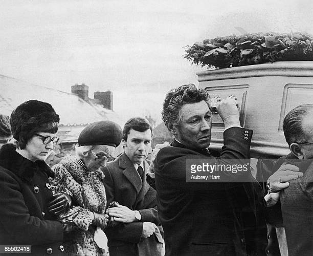 Mourners at the funeral of Lesley Whittle including her mother Dorothy who is being supported between her son Ronald and her sister Sandra Dorrell...