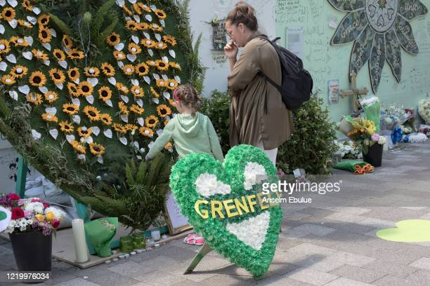 Mourners at the Grenfell memorial display on June 14 2020 in London England Official memorials for the 2017 Grenfell Tower fire which killed 72...