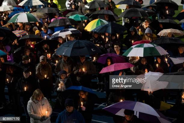 Mourners attend a community vigil at Newtown High School for the victims of last week's mass shooting at Marjory Stoneman Douglas High School in...